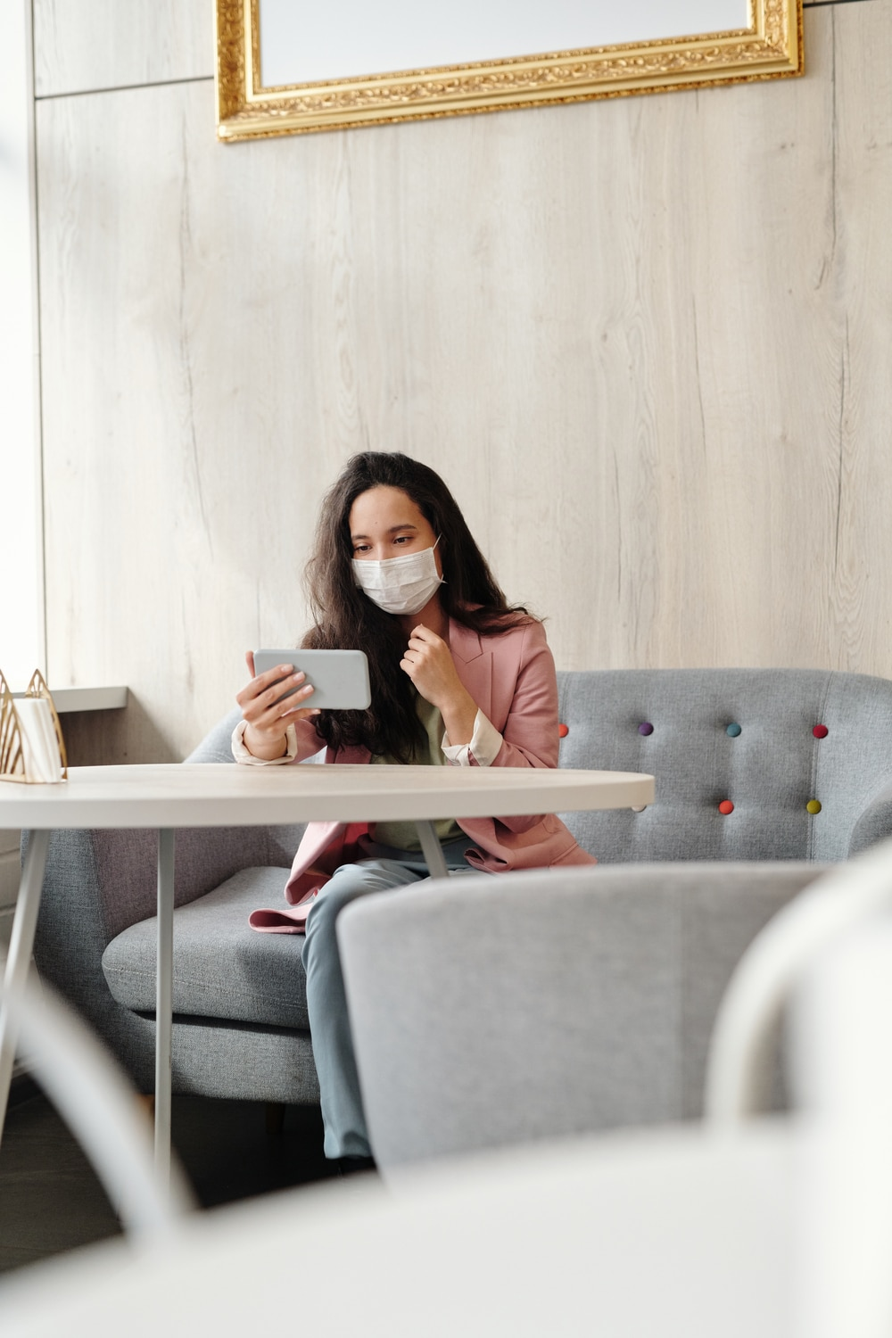 woman on phone wearing a covid-19 mask